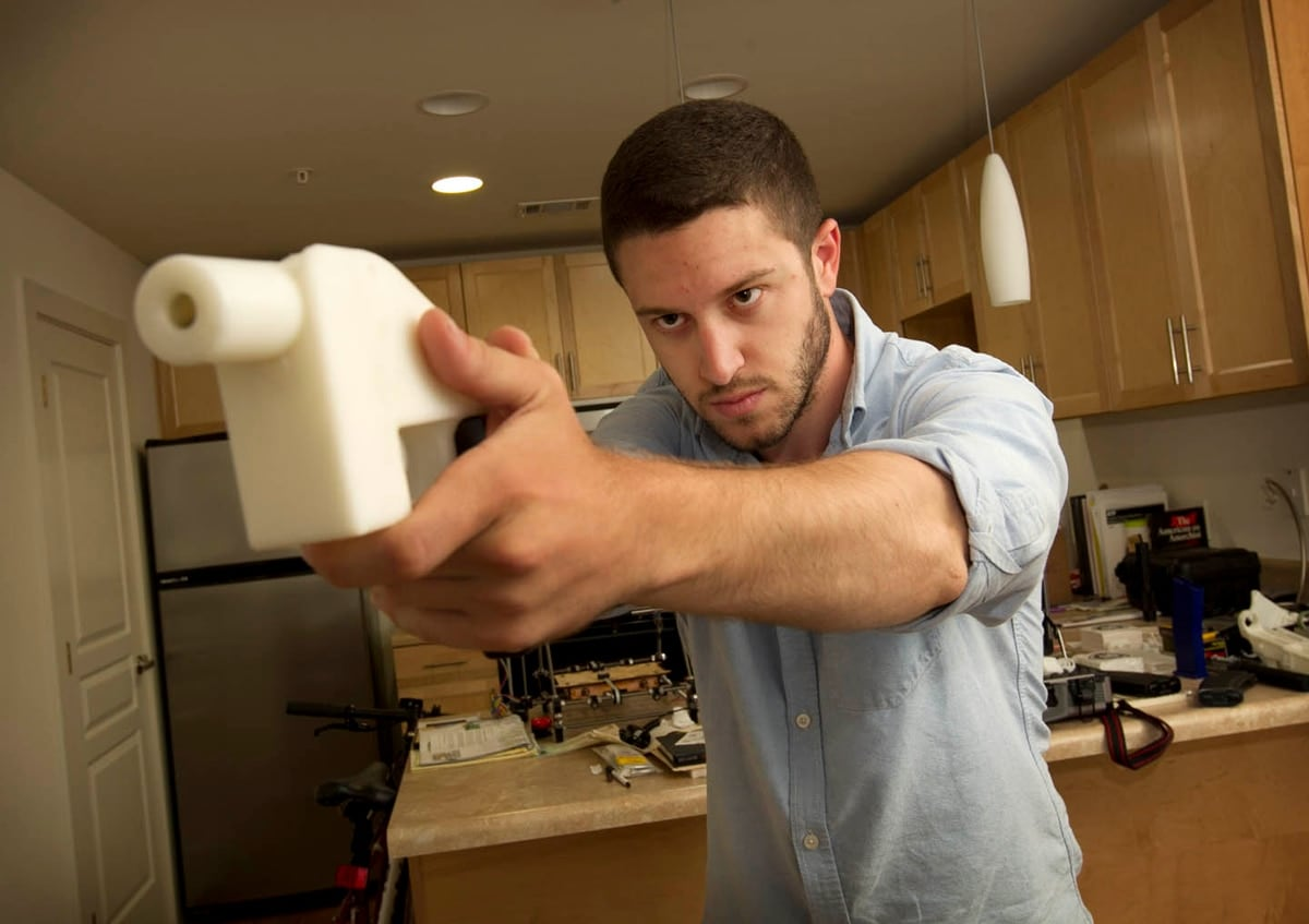 Cody Wilson holds a 3D printed pistol