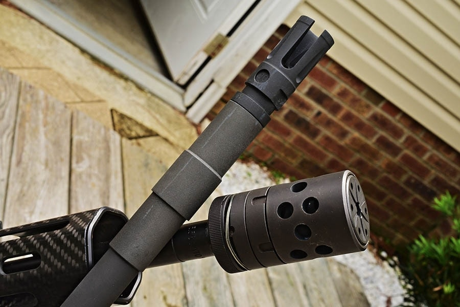Both flash suppressors are compensators have their uses, picking the correct one for your situation is the difficult part. (Photo: Jim Grant)