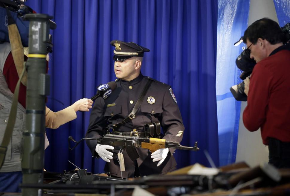 Trenton police Lt. Leonard Aviles holds a semi-automatic rifle at a 2013 gun buyback that collected 2600 firearms. (Photo: AP https://www.nydailynews.com/news/national/rocket-launcher-2-600-weapons-collected-2-day-gun-buyback-event-n-article-1.1251108 )