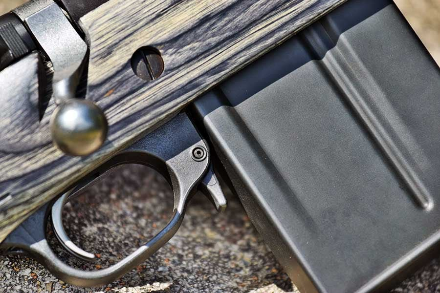 The Gunsite shares its magazine with the high-end AICS rifles, and is inserted similarly to an AK47 's mag by rocking the magazine in at a slight forward angle. (Photo: Jim Grant)
