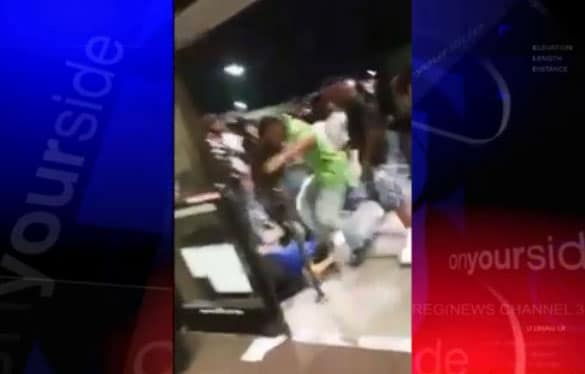 The teen in the lime green shirt, seen here stomping on the victim's head, was arrested early Monday morning. (Photo: WREG)