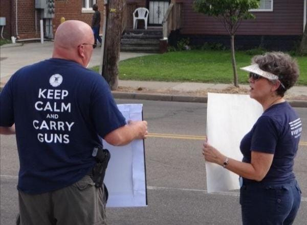 Advocates on both sides of the issue of gun violence took to the streets of Akron, Ohio last weekend, with two different versions of the event. (Photo: Twitter)