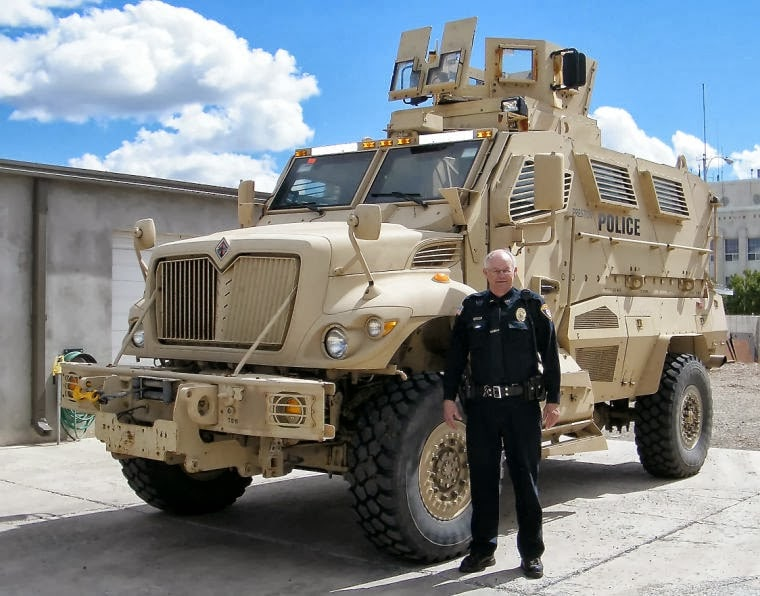 Preston, ID Police Chief Ken Geddes with his six-officer department's surplus MRAP vehicle. The Los Angeles School Police Department has obtained a similar vehicle for use in rescues. (Photo: Idaho State Journal https://www.idahostatejournal.com/news/local/preston-police-chief-touts-acquisition-of-armored-vehicle-for-department/article_9cccbc7c-2742-11e3-8c7e-0019bb2963f4.html )