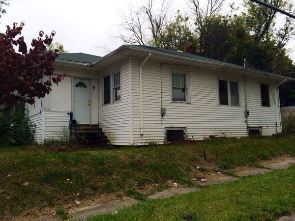 One of the neighborhood residents boarded up the vacant home following the attack. (Photo: Michigan Live)