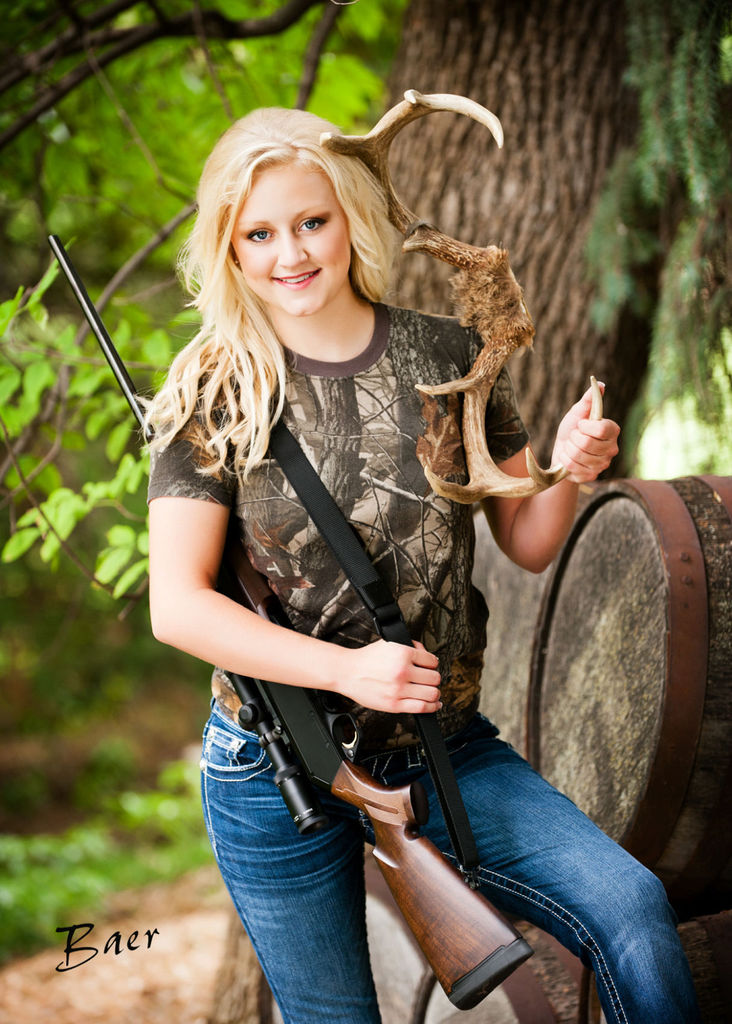 Senior Jillian Dixson of Grand Island, a longtime sports shooter, wanted to pose for her high school pictures with a hunting rifle, and in at least one school in Nebraska; this has the blessing of the school board. (Photo: Brian Baer/Baer Photography via the Omaha World Herald)