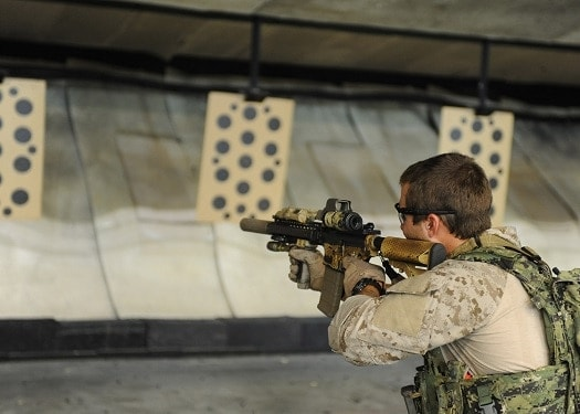 An East Coast based U.S. Navy SEAL (Sea, Air, and Land) practices shooting drills at the Naval Special Warfare Eagle Haven Indoor Shooting Range on Joint Expeditionary Base Little Creek-Fort Story (Photo: U.S. Navy)
