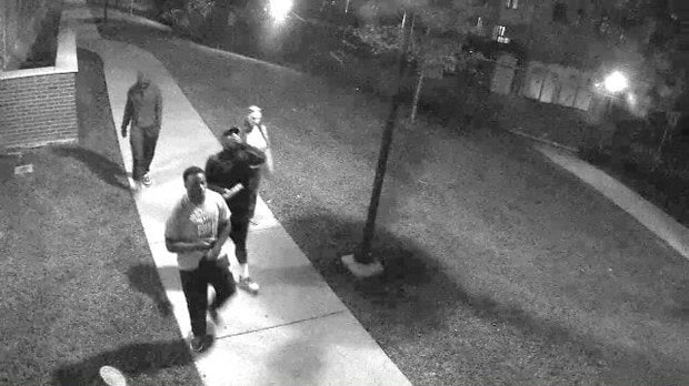 A group of four University of Kentucky football players, shown in this surveillance still, are in trouble after allegedly firing airsoft guns around campus (Photo: Kentucky.com)