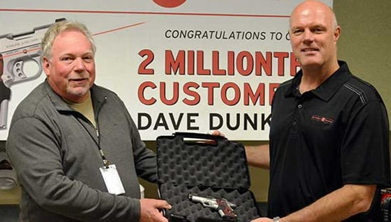 Dave Dunker, left, poses with Crimson Trace CEO Lane Tobiassen at the company's headquarters. (Photo: Crimson Trace)