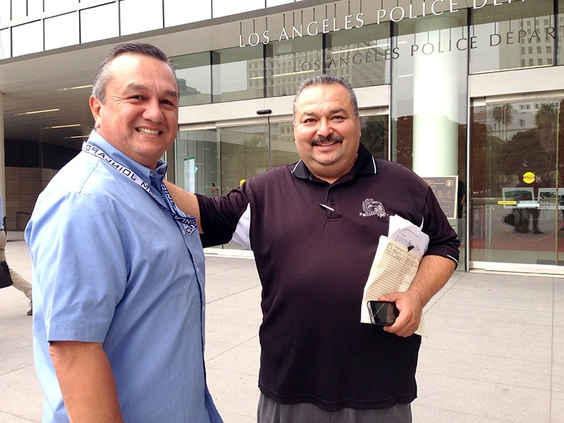 """LAPD detectives David Nunez and Chris Graciano pose for a picture outside of LAPD headquarters after the police board of commissioners """"ghost cars"""" meeting on Oct. 14, 2014. (Photo: Jared Morgan/Guns.com)"""