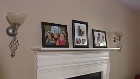 The teen claims the officers implied he did not belong in the house, pointing to the pictures of the white kids as proof. (Photo: ABC 11)
