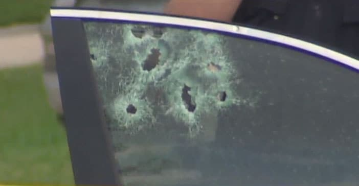 The suspects' getaway car, which was later discovered to be stolen, was riddled with bullet holes. (Photo: KHOU)