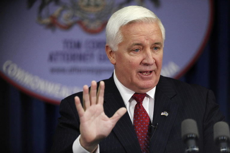 Pennsylvania Gov. Tom Corbett (R) could soon have a bill on his desk allowing the NRA to sue cities and counties in the state over gun laws (Photo: AP)