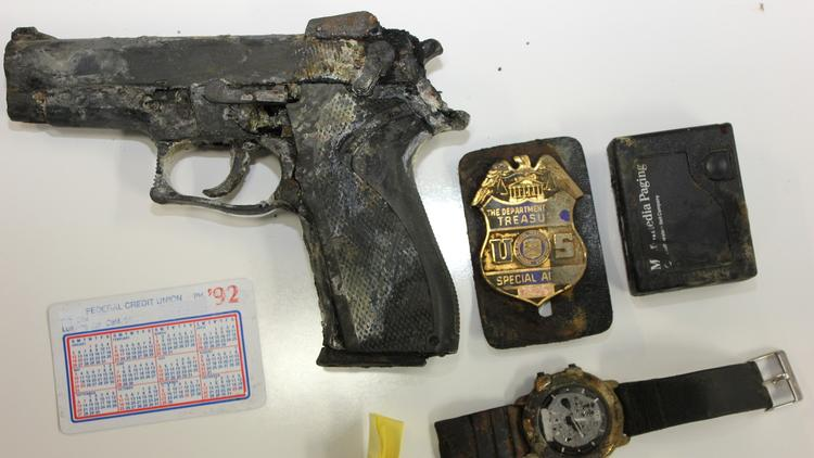 A handgun, badge, and other items lost by an ATF agent in 1992 were found in Castaic Lake this week by a fisherman. (Photo: L.A. County Sheriff's Department)
