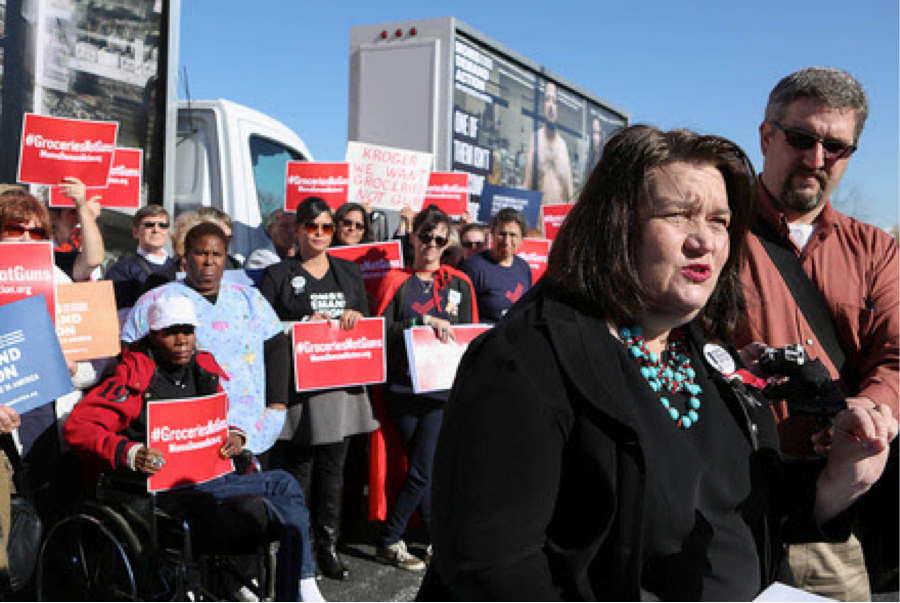 Mary Reed, who survived a 2011 shooting at a Safeway parking lot in Arizona, addressed the crowd of Moms Demand Action protesters at Kroger's investors meeting Wednesday. (Photo: Moms Demand Action)