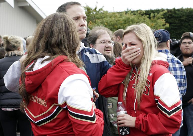 Students and family members reunite at Shoultes Gospel Hall church after an active shooter situation at Marysville-Pilchuck High School in Marysville, Washington October 24, 2014. (Photo: Reuters)