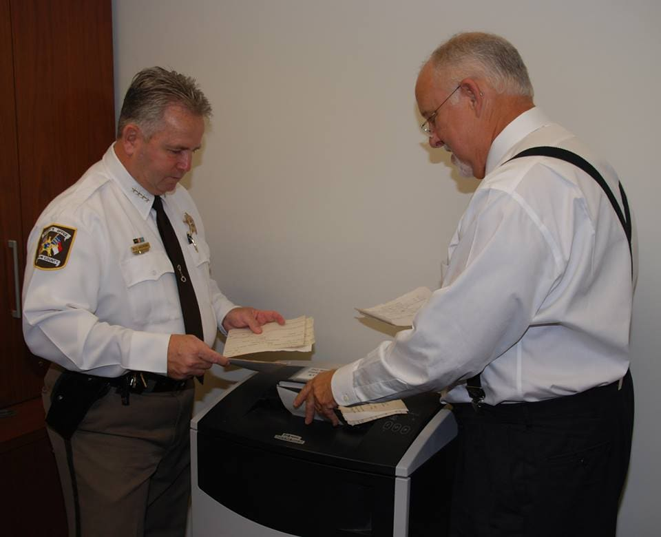 Durham County, NC officials shred decades of firearms registration cards Monday. (Photo: Durham County Sheriff's Office)