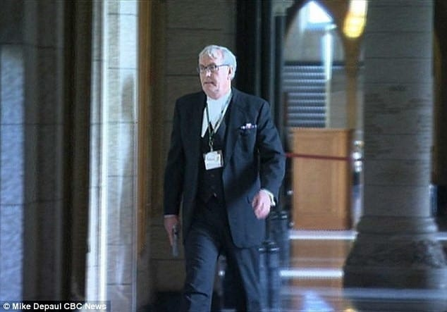 Canadian House of Commons Sergeant-at-Arms Kevin Vickers, normally equipped with a ceremonial mace and sword, retrieved a pistol to end a terrorist's rampage Wednesday. (Photo: CBC)