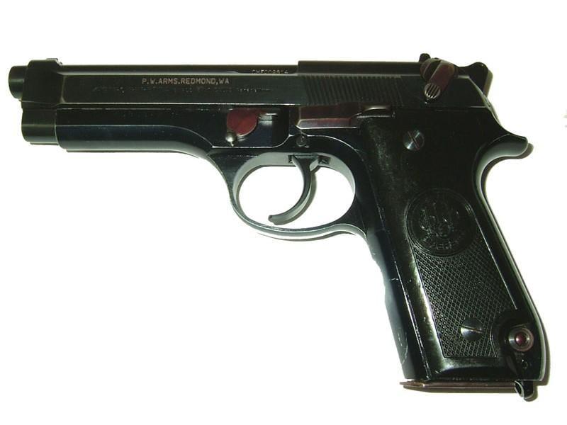 beretta 92 police trade in handgun on white background