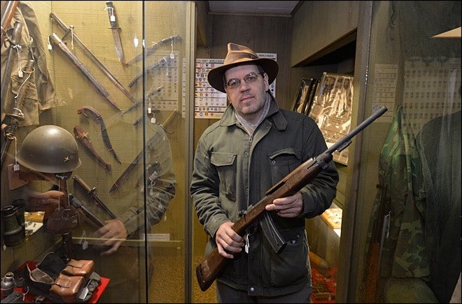 Lynden Pioneer Museum director and curator Troy Loginbill, holds a historic M1 Carbine on loan to the museum. Under the new I-594 ballot measure, he is having to return the guns to their donors. (Photo: Komo News https://www.komonews.com/news/local/New-gun-law-prompts-Lynden-museum-to-remove-WWII-rifles-283197591.html )