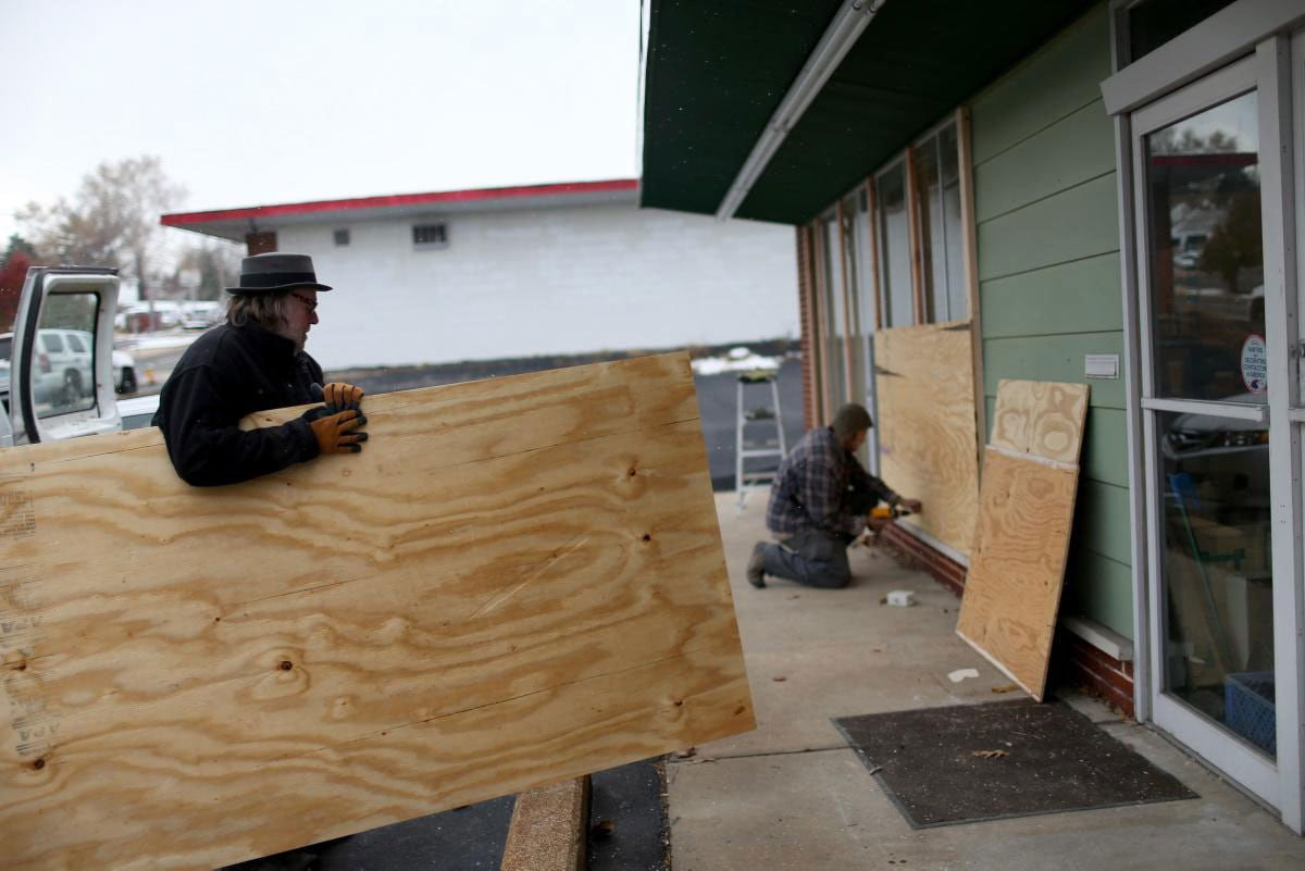 Many local businesses are preparing for a repeat of violence by boarding up windows and doors in an effort to protect their property as best they can. (Photo: New York Daily News)