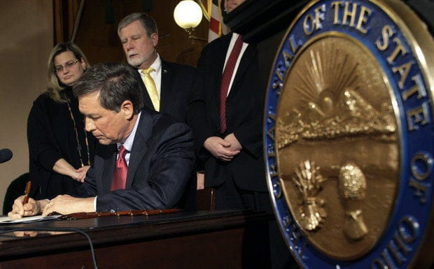 Gov. John Kasich signed 40 bills Friday including H234, which provided sweeping reform to the Buckeye State's gun laws. (Photo: Cleveland.com)