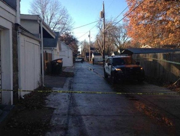 Officers taped off two scenes – the home and the alleyway where the suspect was found – but had to call in additional officers to keep people away from the crime scene. (Photo: The Topeka Capital-Journal)