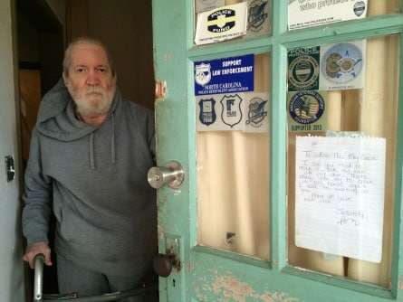Joseph Sapienza taped a note to the front door of the 113-year-old home his grandfather built, warning those with ill intentions not to return. (Photo: Gaston Gazette)