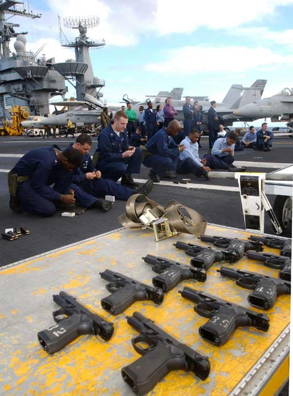 U.S. Navy personnel prepare for small arms training on the deck of the USS Harry S. Truman. Legislation in Ohio could allow service members to carry concealed firearms for protection without a permit. (Photo: Department of Defense.)