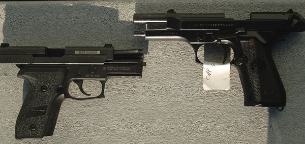 Sig Sauer P229 alongside the Beretta M9.
