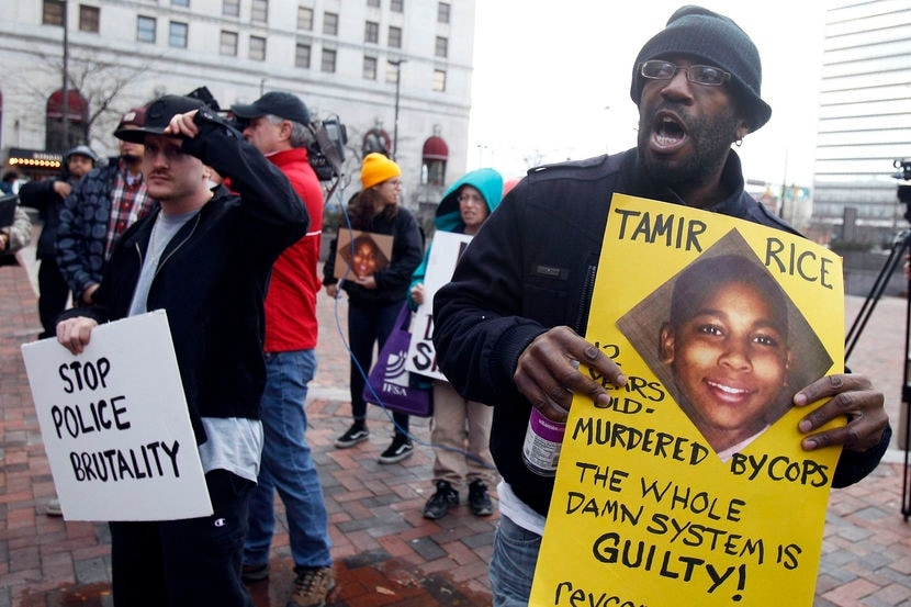 Protesters march during a rally at Public Square in Cleveland, Ohio, USA, 24 November 2014. Following the 22 November fatal shooting of 12 year old Tamir Rice by a Cleveland Police officer. According to reports, police shot Tamir Rice in the chest near the city's Cudell Recreation Center on 22 November, when he reached into his waistband for a gun that turned out to be a fake.  (Photo: EPA)