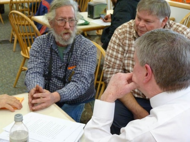 Ed Cutler, president of Gun Owners of Vermont, speaks with state Senate President John Campbell (D) in the Statehouse cafeteria this week. (Photo: Morgan True/VTDigger)