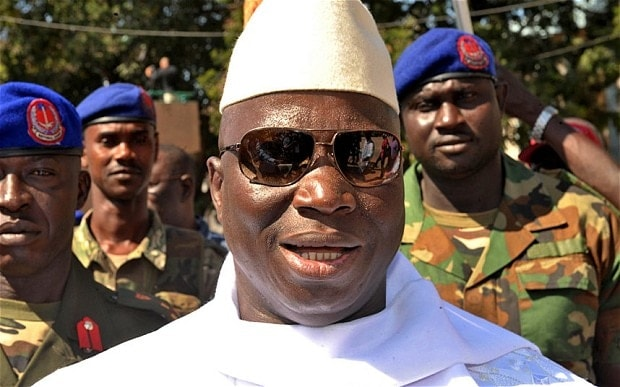 President Yahya Jammeh of Gambia, seen here inspecting troops of that country's military, just survived a coup led by two U.S. citizens. (Photo: The Telegraph of London)