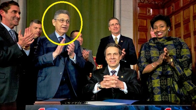Silver, circled, was a primary backer of the 2013 New York SAFE Act shown just after its signing by Gov. Andrew Cuomo (D). (Photo: AP)