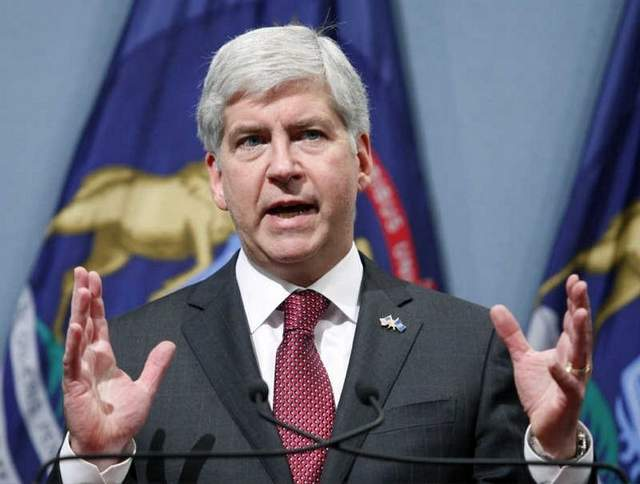 Michigan's Republican Gov. Rick Snyder dropped veto ink all over a pair of gun rights bills Thursday that would have reformed the state's concealed carry laws. (Photo: AP)