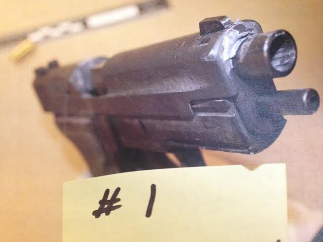 One of the bullets struck the suspect's gun.
