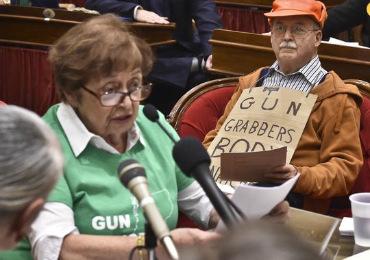 Green-clad gun control advocates and Second Amendment supporters in orange faced off at a public meeting at the Vermont Statehouse in Montpelier. (Photo: Glenn Russel/Free Press)