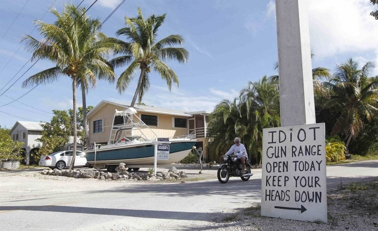 A sign set up on Big Pine Key by angry neighbors warning of Doug Varrieur's backyard gun range in 2014 before he dismantled it. (Photo: Andrew Innerarity/Reuters)