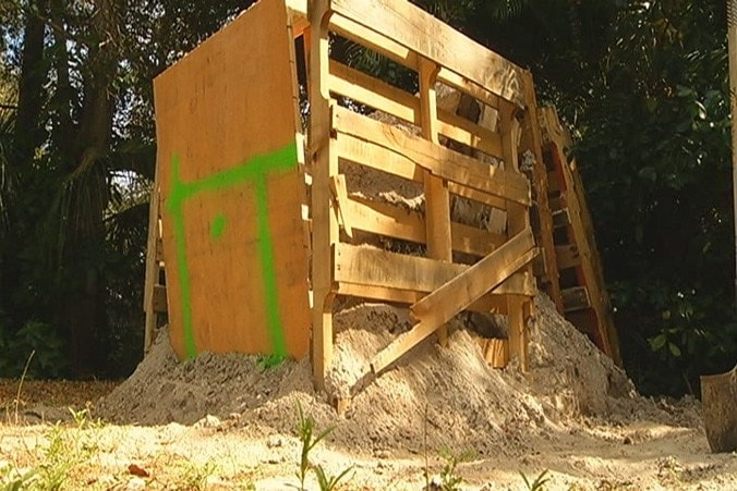 Joey Carannante's homemade range, consisting of pallets and sand, is drawing complaints from his neighbors who are petitioning to have it removed. (Photo: Bay News 9)