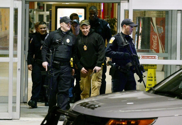 Police exit the Monroeville Mall Saturday, Feb. 7, 2015, after a shooting that left three in the hospital. As a byproduct, of that event, youth under age 18 will not be allowed in on weekend nights without an escort. (Photo: Bill Wade/Pittsburgh Post-Gazette)