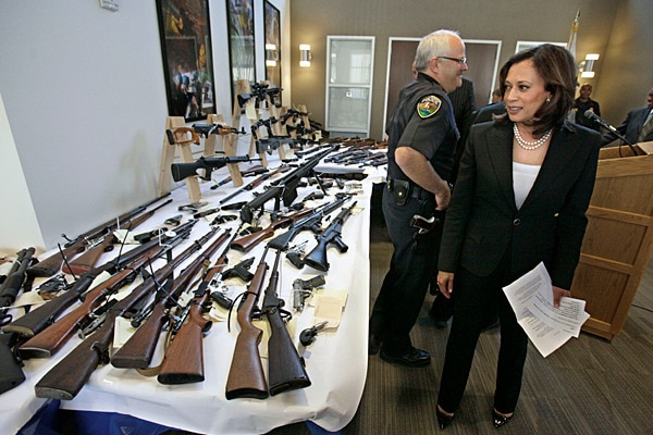 California Attorney General Kamala Harris looked over some of the guns seized from individuals legally barred from possessing them following a news conference in Sacramento, Calif., in June 2011. (Photo: Rich Pedroncelli/AP)