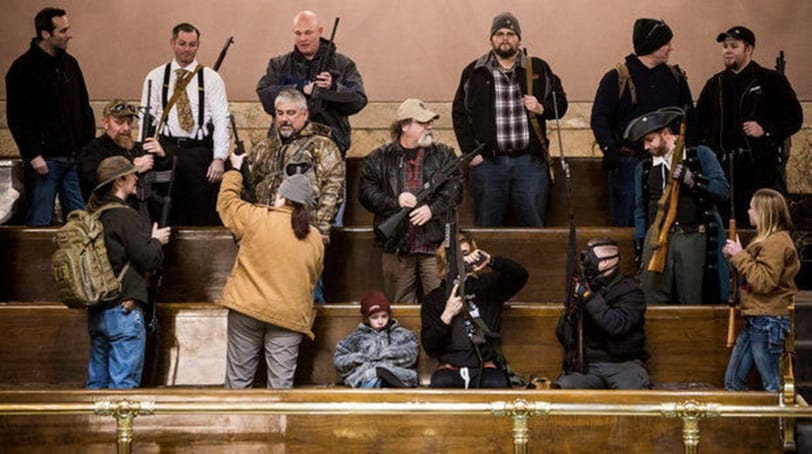 Gun-rights protesters carried firearms into the Washington Capitol during a protest against a new voter-approved law expanding background checks on gun purchases. Oregon lawmakers this session will consider a similar bill. (Gun-rights protesters carry firearms into the Washington Capitol during a protest against a new voter-approved law expanding background checks on gun purchases. Oregon is considering a similar law. (Photo: The Associated Press)