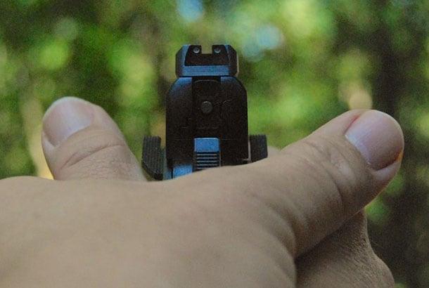 thumbs crossed handgun grip