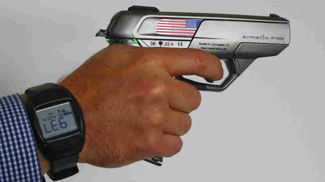 The German-made Armatix iP1 smart gun, which uses an RFID technology watch to unlock it, was marketed last year in California without success. (Photo: NPR)