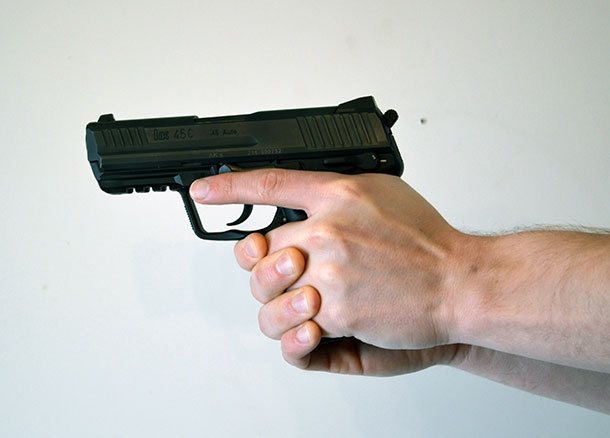 Strong hand over support hand handgun