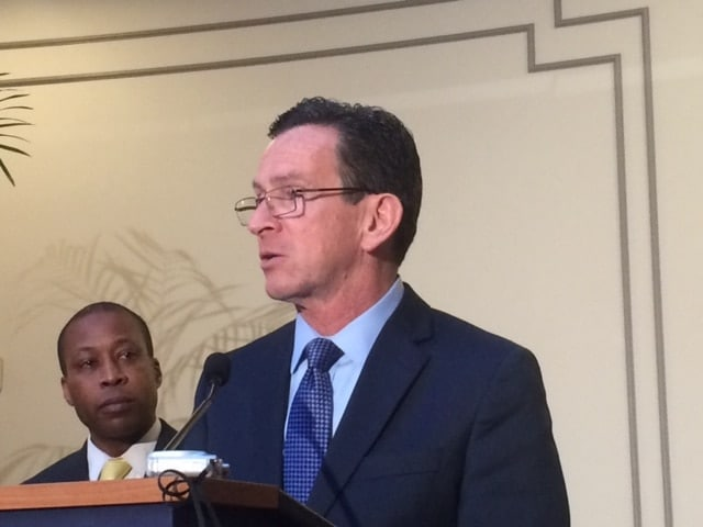 Connecticut Gov. Dannel P. Malloy accepted the special Sandy Hook Advisory Commission's final report Friday from panel chair Hamden Mayor Scott Jackson, seen in background. (Photo: CT Mirror)