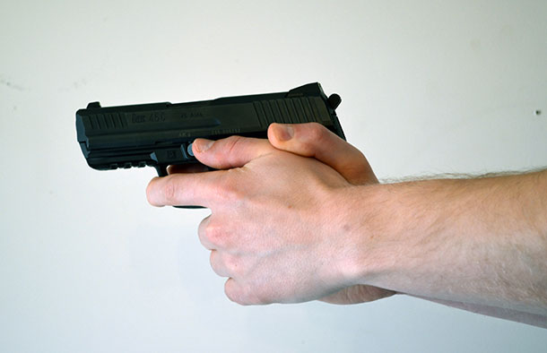 Finger over the trigger guard pistol grip