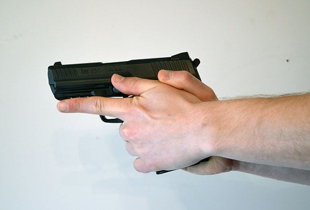 Index finger pointed handgun