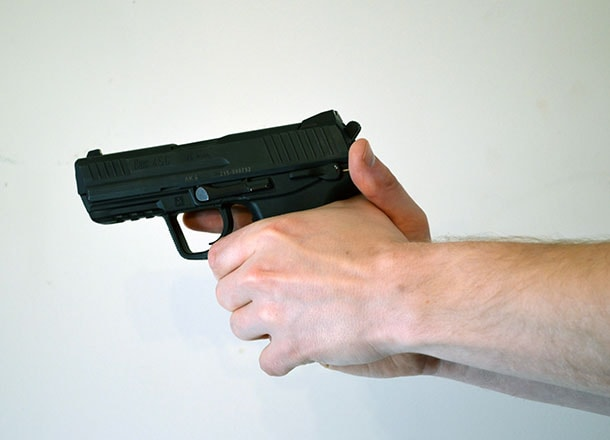 Crossed thumb pistol grip