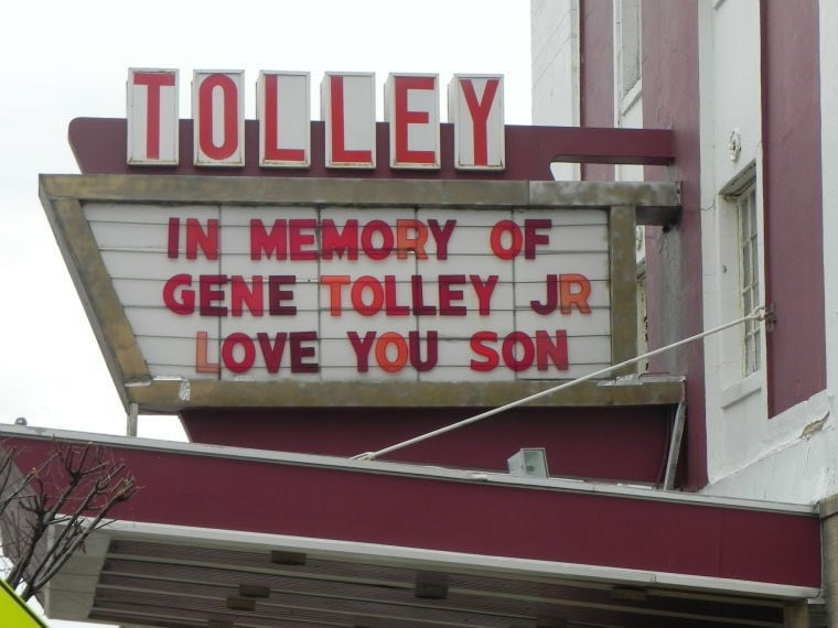 A tribute to Eugene Tolley is displayed on a sign outside a restaurant equipment and catering business owned by Tolley's father. (Photo: The Star Democrat)
