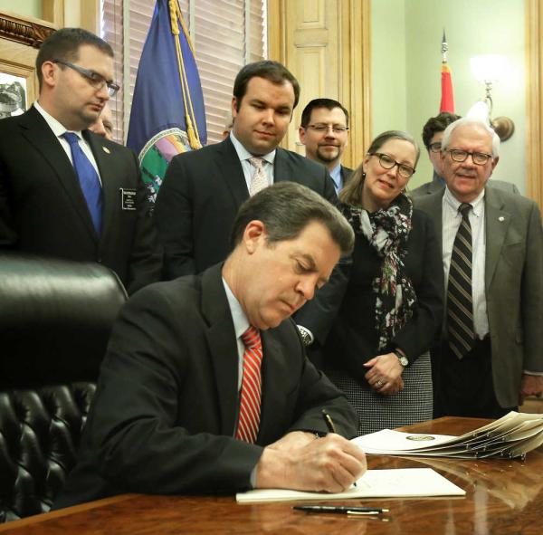 Gov. Sam Brownback wasted no time signing a measure to bring constitutional carry to Kansas. (Photo: Thad Allton/The Capital Journal)